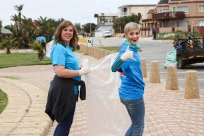 Woodlands Dairy - First Choice employees clean up at main beach